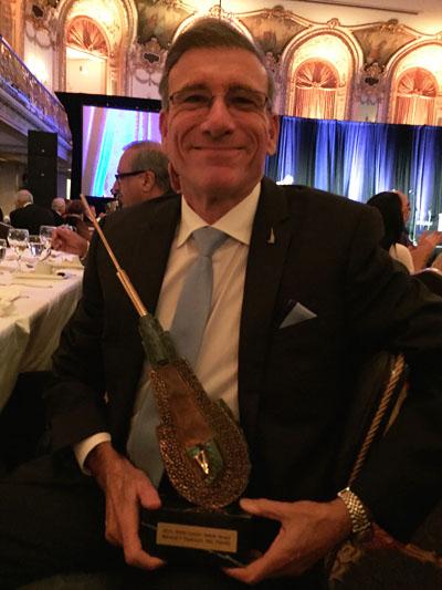 Dr. Nusbaum holding Golden Follicle Award